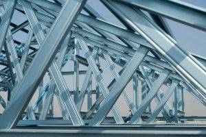 steelStructure of steel roof frame for building construction on sky background.